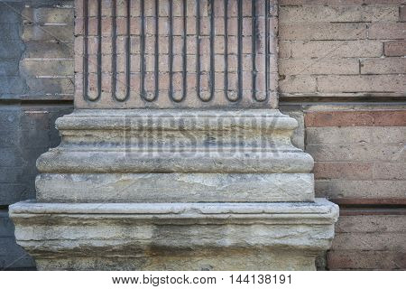 Fragment of ornamental column on a brick building in Toulouse, France.