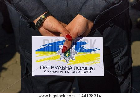 Uzhgorod Ukraine - August 25. 2016: Police woman holding an envelope with the epaulets of lieutenant during the ceremony of awarding titles to inspectors of police officers.
