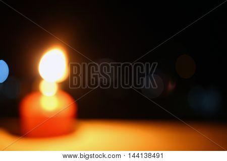 Oil Lamp - Pelita in its original ambient lighting at night. Out of focus