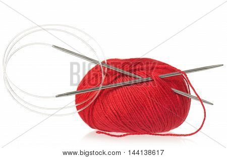 Red yarn threads with spokes for knitting isolated on white background