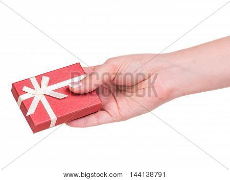 Female hand with little gift box isolated over white background