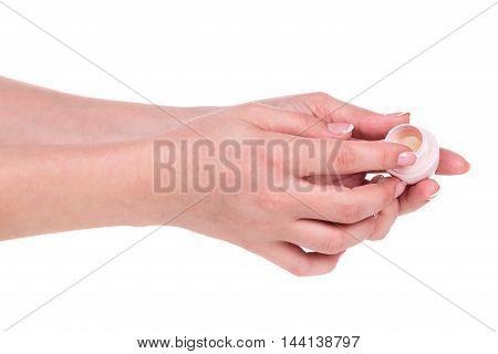 Young female hand with cream isolated over white background