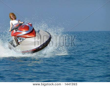 Young Woman Riding A Jet Ski