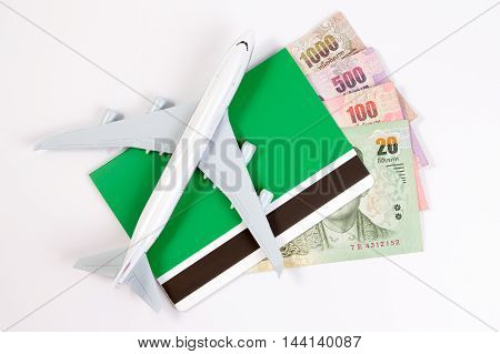 Airplane On Thai Money, The Rising Costs Of Airline Travel. Airline Tickets Or Book Bank Isolated On