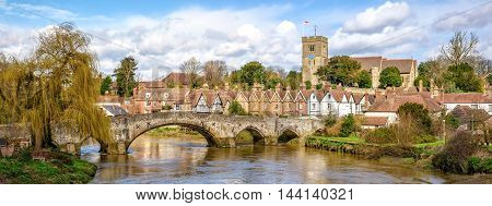 Panoramic view of Aylesford village in Kent England with medieval bridge and church.