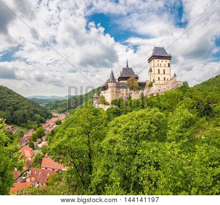 Karlstein Czech Republic - May 26 2016: Panoramic view of Karlstein Castle - large Gothic castle founded in 1348 by King Charles IV Holy Roman Emperor and King of Bohemia. The castle served as a place for safekeeping the Imperial Regalia Bohemian/Czech cr