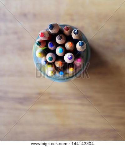 Colored drawing wood pencils container. Back to school