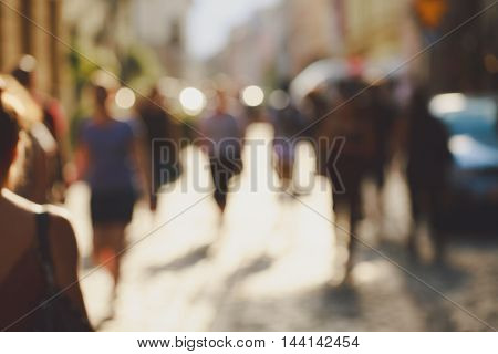 Crowded blurred street in Europe. Blurred unrecognizable people background.