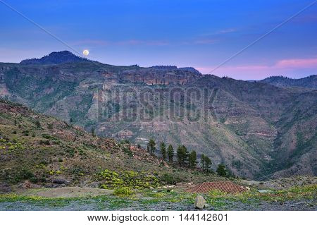 Moon rising in the mountains of Gran Canaria island, Spain