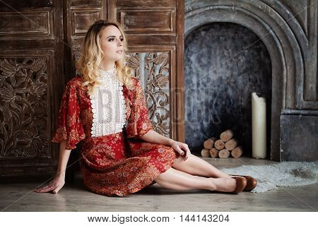 Perfect Woman with red dress in dark Vintage Interior