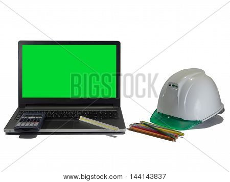Laptop Safety Helmet pencil and calculator shows that it is a tool of engineers in engineering.mornitor green on white backgoung.It is isolate