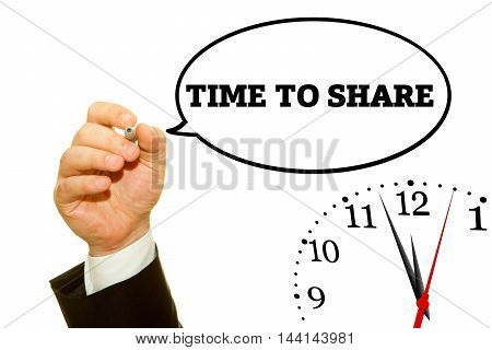 Businessman hand writing TIME TO SHARE message on a transparent wipe board.