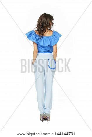 Rear view of a model in fashionable clothes isolated on white