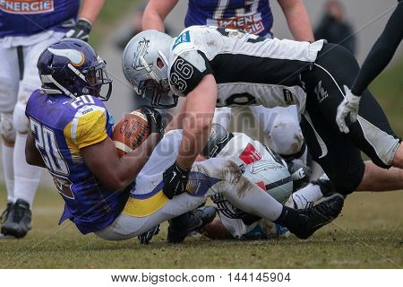 VIENNA, AUSTRIA - MARCH 22, 2015: LB Philipp Margreiter (#36 Raiders tackles RB Islaam Amadu (#20 Vikings) in a game of the Austrian Football League.