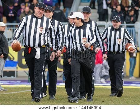 VIENNA, AUSTRIA - MARCH 22, 2015: The referee crew walks on the field before a game of the Austrian Football League.