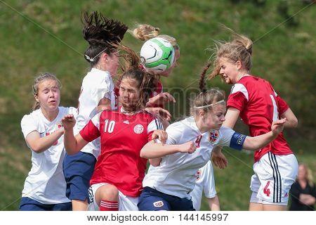 LINDABRUNN, AUSTRIA - APRIL 13, 2015: Mille Gejl (#4 Denamrk) and Ingrid Kvernvolden (#6 Norway) fight for the ball during a UEFA women's U17 qualifying game.