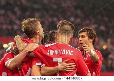 VIENNA, AUSTRIA - MARCH 31, 2015: Marc Janko (#21 Austria), Marko Arnautovic (#7 Austria) and Aleksandar Dragovic (#3 Austria) celebrate during an European Championship qualifying game.