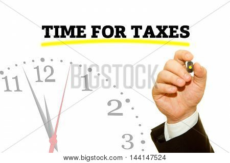 Businessman hand writing TIME FOR TAXES message on a transparent wipe board.