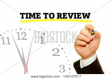 Businessman hand writing TIME TO REVIEW message on a transparent wipe board.