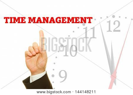 Businessman hand writing TIME MANAGEMENT message on a transparent wipe board.