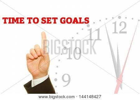 Businessman hand writing TIME TO SET GOALS message on a transparent wipe board.