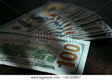 dollar bills lying like a fan on the table
