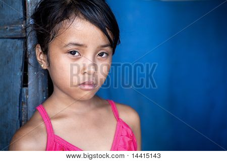 Young Asian Girl Over Blue
