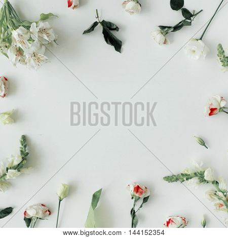Wallpaper texture frame. Pink roses and white flowers on white background. Flat lay top view