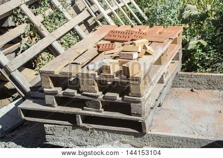 Pallets And Remaining Balance Of A Brick
