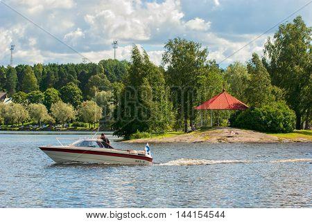 LAPPEENRANTA, FINLAND - AUGUST 8, 2016: Boat floats near pavilion on The Halkosaari Island on Saimaa Lake