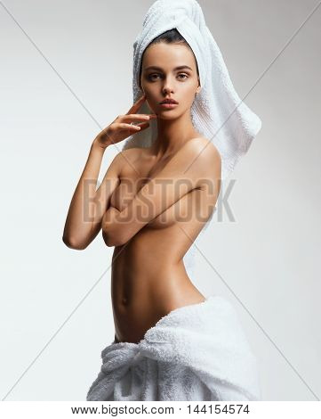 Beautiful slim girl with tanned body after spa. Beauty & Skin care concept