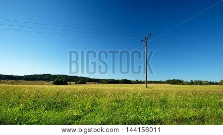 Summer Meadow With Single Electric Pillar