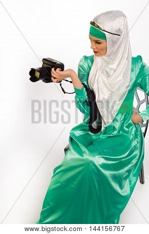A Woman In A Hijab, Holding A Camera