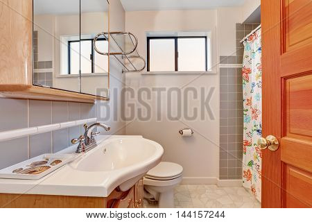 Light Tones Bathroom Interior With Grey Tile Wall Trim