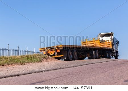 Truck with yellow haulage trailers awaiting cargo