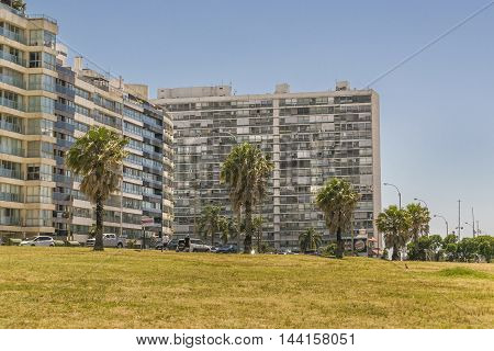 MONTEVIDEO, URUGUAY, DECEMBER - 2015 - Urban scene depicting modern apartements buildings in front of coast at Pocitos neighborhood in Montevideo Uruguay