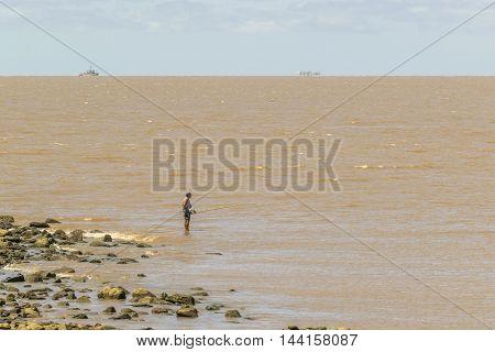 MONTEVIDEO, URUGUAY, - DECEMBER - 2015 - Adult fisherman fishing at river in Montevideo Uruguay