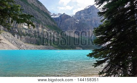 beautiful lake clear blue water with blur of people canoeing on background
