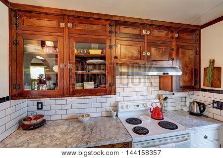 Vintage Kitchen Cabinets And White Tile Back Splash Trim