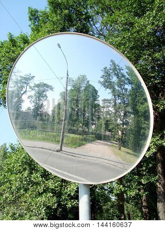 Review spherical mirror reflects the street. Built for safety on the roads.