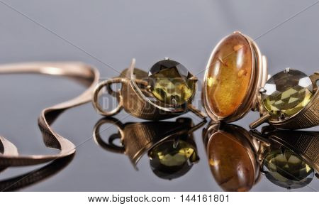 Old Gold Earrings With Green Stones And A Ring With Amber