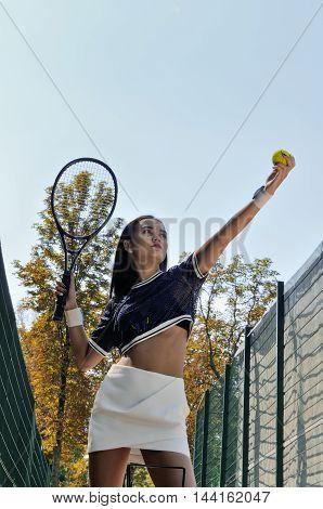 Girl Swings The Racket Tennis Ball.