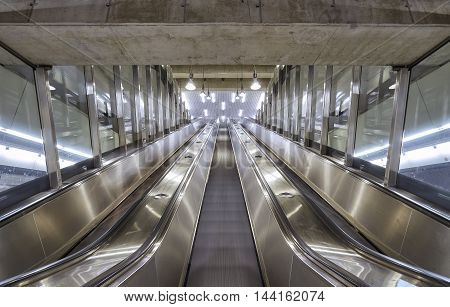 Low angle view of a subway underground escalator.