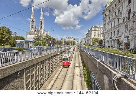 Vienna, Austria - August 14, 2016: Tram Entering Tunnel With Votive Church In Distance.