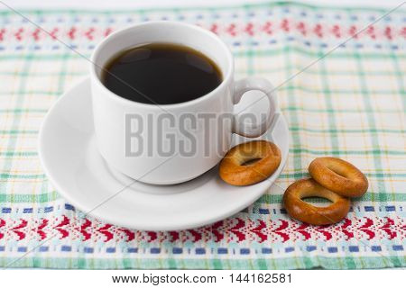 Cup Of Coffee With Drying On A Napkin.