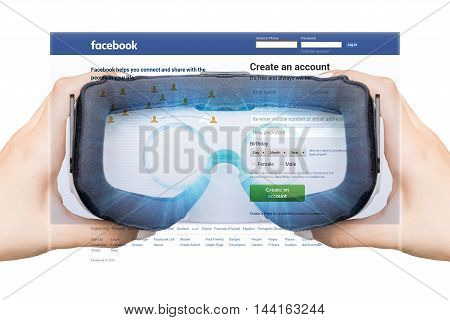 USA, Washington - August 24: 2016 Woman register with a social network Facebook. In virtual reality with the assistance of eyeglasses augmented reality, VR
