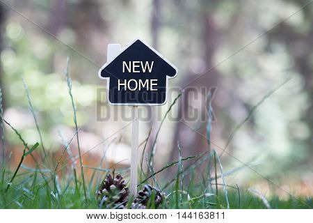 House Shaped Chalkboard sign on nature NEW HOME