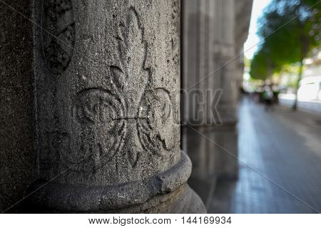 Shot of the concrete column with pattern on it. City of Barcelona, Spain