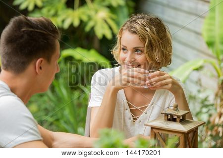 young happy couple drinking water and laughing