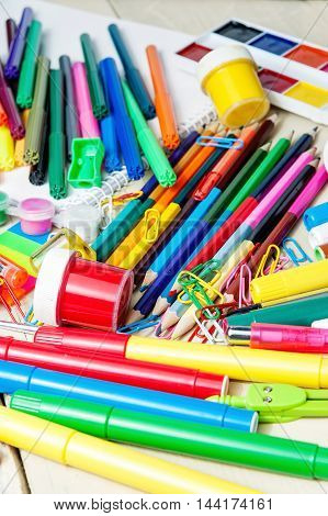 Full background of a colorful assortment of school supplies